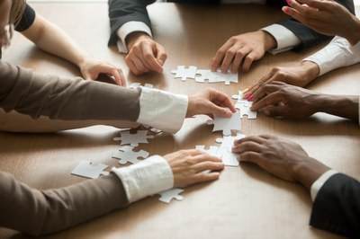 Many hands solving a puzzle